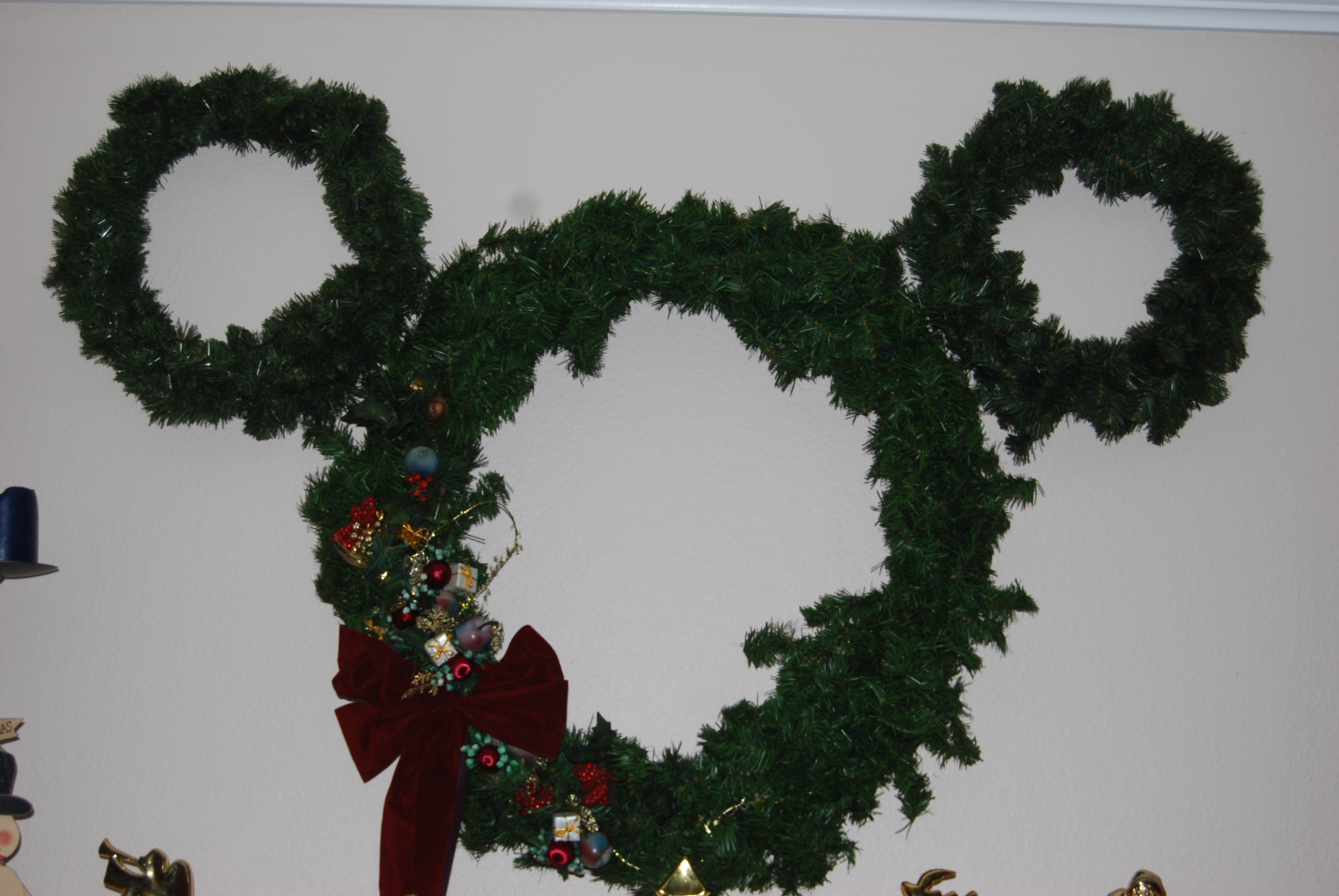 We know it's Christmastime...when the Mickey wreath goes up.
